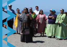 Photo of Native Americans gathered at the beach