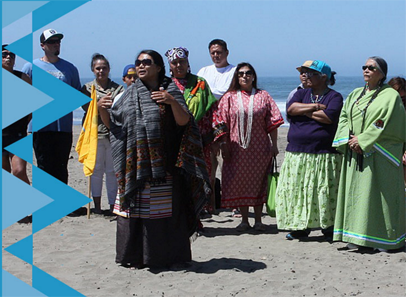 Photo of woman speaking at Oakland's Native American Health Center Annual Water Walk Ceremonial
